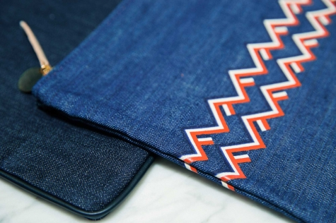 """Printing on leather is very difficult to do in the U.S., where we manufacture everything. To print on denim was a fun solution. This clutch with the chevron was actually the first piece we did in denim."""