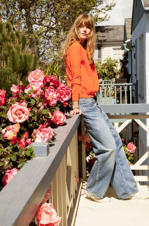 Model Frida Gustavsson wears Acne's Drift Vintage jeans at her temporary home in Venice, California.