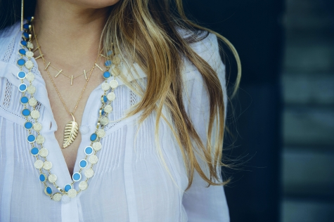 Wearing her own jewelry designs – the diamond large leaf, the diamond cross bar, the gold-and-turquoise inlay circle link, and the diamond circle link necklaces.