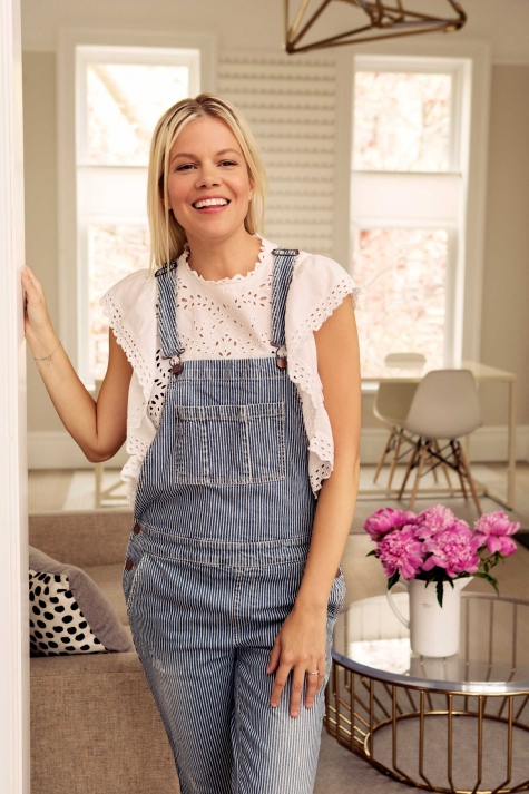 Designer Jessie Randall at home in Brooklyn in her favorite Forever21 overalls.